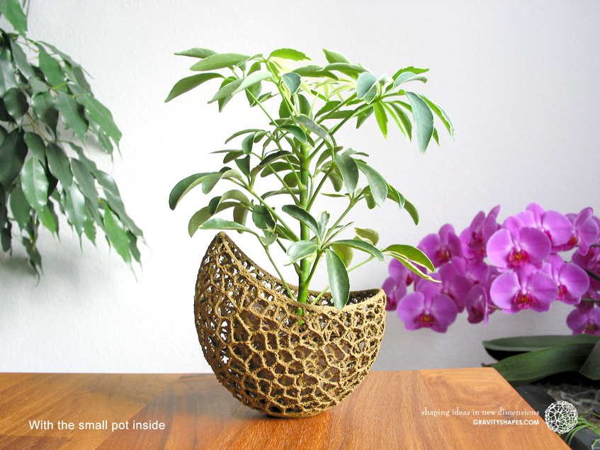 A burgeoning capsule Planter with small Pot